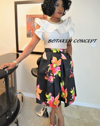 PERFECTIONIST BLACK/MULTI BALL SKIRT WITH SIDE POCKETS.