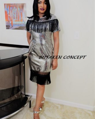 ELEGANT FACTOR BLACK AND SILVER EVENING DRESS. Price is marked 25% off.